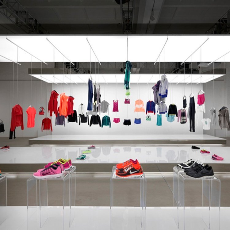 Creative attractive clothing showroom design for clothing display