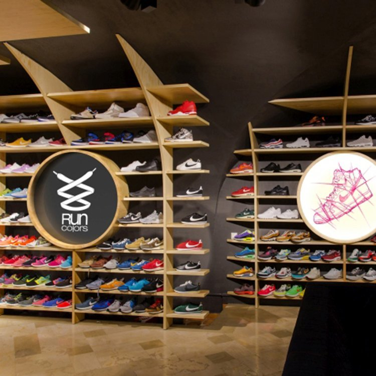Customized creative wooden shoe cabinet for run shoes shop interior design